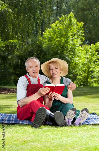 Married couple resting in garden