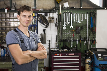 Portrait of car mechanic in garage