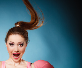 Face expression of funny teen girl on blue