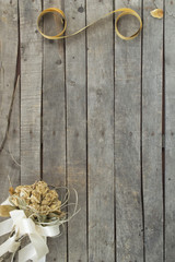 bouquet and ribbon on wooden background