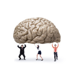 Business team holding a brain