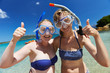 Happy vacation girls with snorkel masks