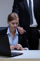 Woman doesn't like boss's touch