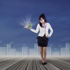 Businesswoman looking business chart