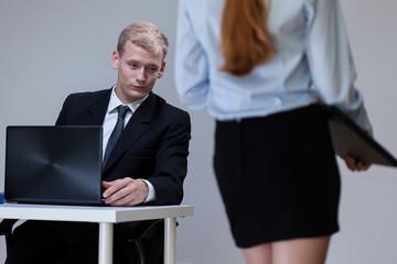 Man observing co-worker's legs