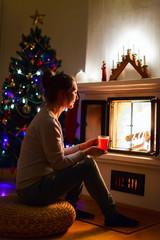 Young woman on Christmas eve