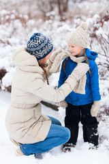 Mother and daughter outdoors on winter
