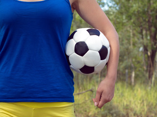 Girl holding a classical football sports ball for soccer
