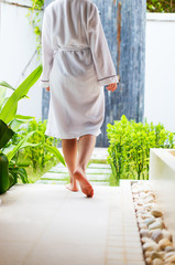 Woman at outdoor spa treatment room