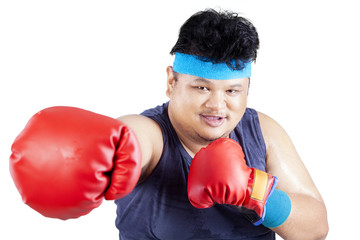 Overweight man exercise by boxing