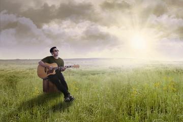 Singer playing guitar outdoors