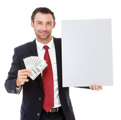 Smiling young business man holding a placard