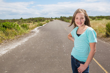 Pretty young girl on a quiet road