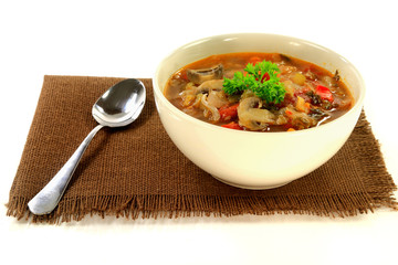 Cabbage, vegetables and mushrooms vegetarian soup