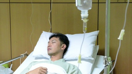 intravenous drip man in the hospital
