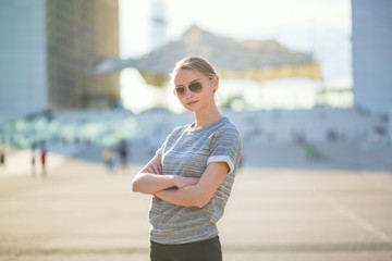 Confident woman in business district of Paris