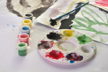 watercolor plate with child's paint picture