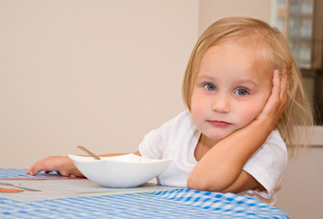 child eats in the kitchen