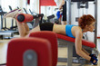 Redhead girl hard training on sports bench