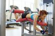 Image of female athlete exercising on bench