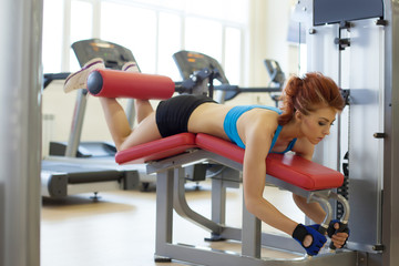Image of female athlete exercising on bench