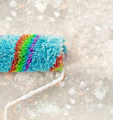 white textured background and colorful paint roller