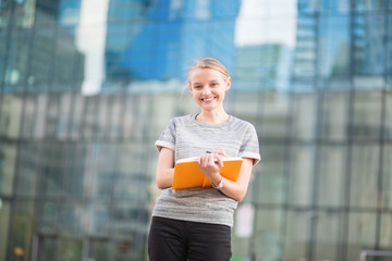 Smiling young woman with notebook
