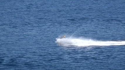 a man rides a jet ski. 4K