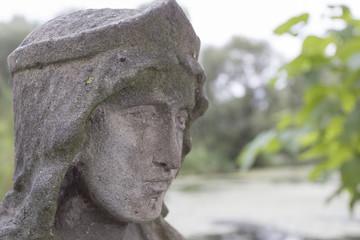Face stone sculpture monk