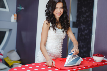 Happy young pretty woman ironing services.