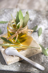 Small glass jar containing olive oil