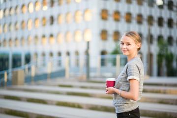 Young beautiful woman having her coffee break
