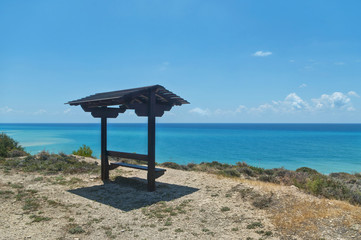 bench with roof facing sea