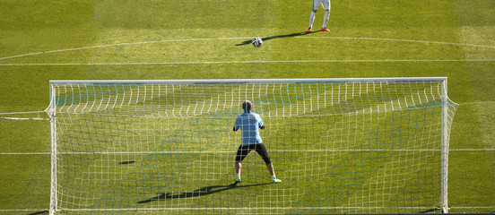 goalkeeper running and warming up before a football game