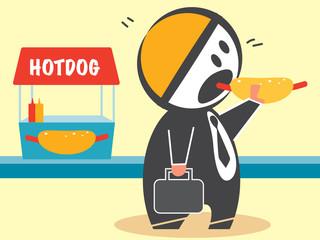 Businessman eating hotdog