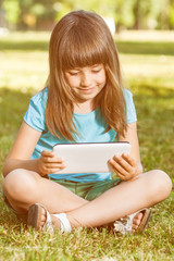 Little girl with tablet computer