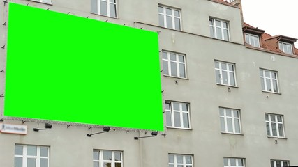 billboard on the city building - green screen
