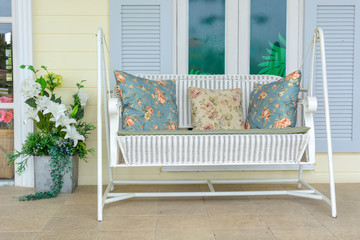 white swing bench with pillow