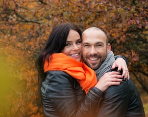 Happy middle-aged couple outdoors on an autumn day
