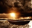 Wooden boat in a stormy sea - 69189109
