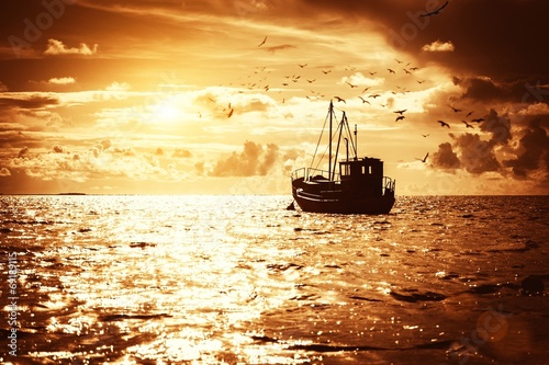 Leinwandbild Motiv Fisherman's boat in a sea