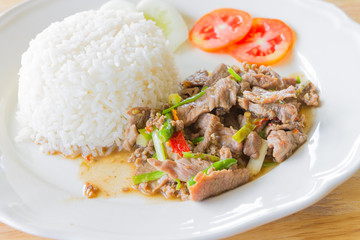 Sliced pork fried with chilies