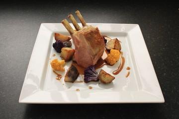 roast rack of lamb plated dinner