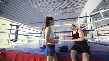 Young and successful boxing coach welcomes female athlete