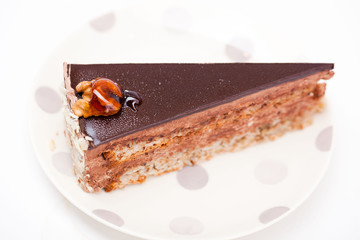 cake with chocolate frosting, walnuts and caramel