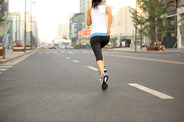 Runner athlete running on city road