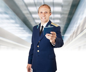 Airport service man with  documents on the flight in hand