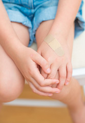 Child hand with an adhesive bandage.
