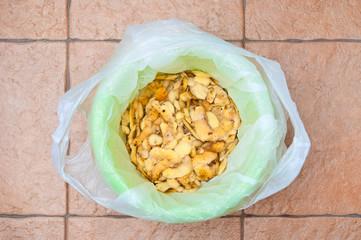 Garbage bin filled potatoes peel