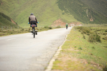 mountain bike rides along the trail on the high mountains of tib